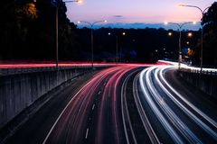 Traffic light trails at dusk down Ryde Road, seen from the Pacific Highway Bridge at Pymble. Pymble, Sydney, Australia - April 20 2019: Traffic light trails at royalty free stock image