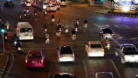 Traffic light trails in modern city at night,Democracy Monument Thailand stock video footage