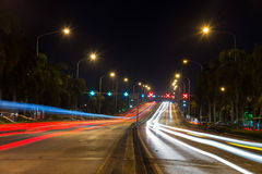 Traffic light trails in modern city at night Royalty Free Stock Photo