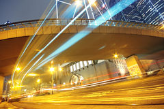 Traffic light trails in the street Stock Images
