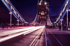 Traffic light trails on Tower Bridge in London at night Stock Image