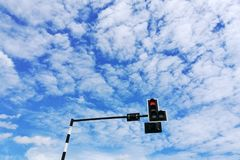 Low angle with Cloudy. Traffic Light under clear sky Royalty Free Stock Images