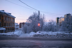 Traffic light on the winter street in Murmansk, Russia Stock Images