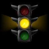 Traffic light with yellow on Royalty Free Stock Images