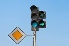 Traffic Lights. With additional section right turn and sign main road Stock Photography