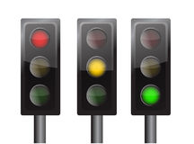 Traffic lights. Green yellow and red traffic lights isolated over a white background Royalty Free Stock Photography