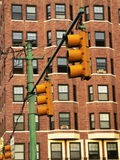 Traffic lights. Traffic light in front of apartment building Royalty Free Stock Images