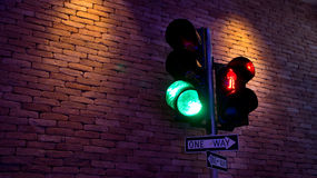 Traffic lights. Urban traffic lights on amber with brick wall background Royalty Free Stock Images