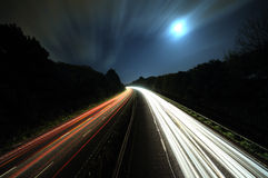 Traffic lights. Traffic light trails on busy highway(A38) UK Royalty Free Stock Images