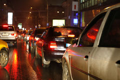 Traffic lights. Traffic jam lights in a rainy night in the city Stock Image