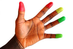 Traffic Lights. This is an image of a black hand with various different coloured finger tips. Metaphor for trafiic lights Stock Photography