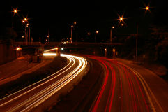 Traffic Lights. Blurred white and red traffic light trails on busy multiple lane street at night stock images