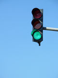 Traffic lights. Green traffic lights on blue sky background Stock Image