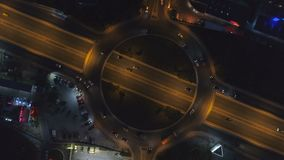 Traffic lights from above. Night traffic at roundabout in Sofia, Bulgaria. Traffic lights from above, 4k drone view stock video footage