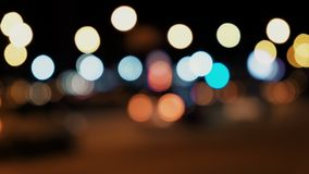 Traffic lights abstract defocused. Defocused night traffic Urban Night Scene stock video