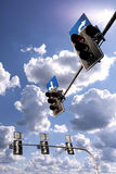 Traffic lights against a vibrant blue sky with clouds Royalty Free Stock Photo