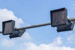 Traffic lights against a vibrant blue sky. Copy-space Royalty Free Stock Image