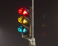 Traffic lights for bicycle. Traffic lights especially for bicycles, very common in Holland. Long shutterspeed to get all the colors Royalty Free Stock Photo