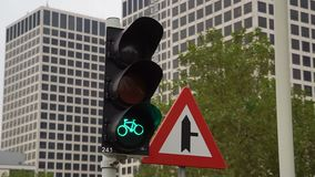 Traffic lights for Bicycles at the intersection. Red traffic lights for bikes stock video
