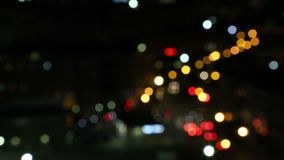Traffic lights bokeh video. Colorful traffic lights bokeh in the city stock footage