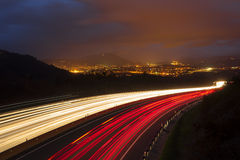 Traffic lights, car lights at night on the road Stock Photo
