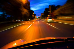 Traffic lights. In car shot at the evening Stock Image