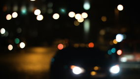 Traffic lights on the city roads. Blurred defocused light on traffic in the deep dark night. Traffic lights on the city roads.  Blurred defocused light on stock video