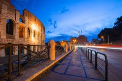 Traffic lights at the Colosseum at dawn in Rome, Italy. Night roman coliseum ancient landmark travel history dusk architecture italian monument twilight royalty free stock photo