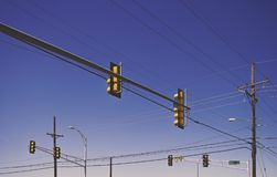 Traffic lights with blue sky - with filter. Traffic lights at a crossroad with a clear blue sky - with filter effect - USA Stock Photography