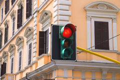 Traffic lights at the crossroads of the city is lit red Stock Photos