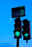 Traffic lights in the evening. Green light traffic lights in the evening Royalty Free Stock Image