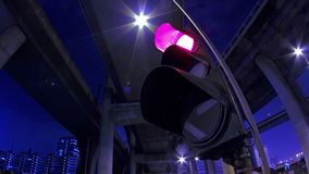 Traffic Lights Flashing at Night. Royalty Free Stock Images