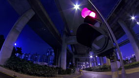 Traffic Lights Flashing at Night. Stock Photo