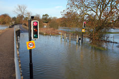 Traffic lights on a flooded road. Stock Photo