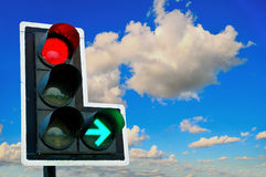 Traffic lights - on in front of blue sky Stock Images