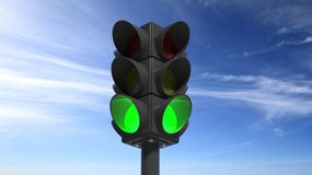 Traffic lights on green Royalty Free Stock Photos