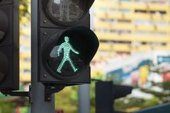 Traffic lights with the green light in the city. Close up Stock Images