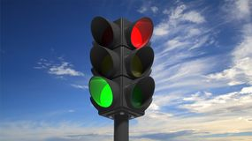 Traffic lights on green and red Stock Image