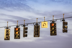Traffic lights hanging above street Stock Photography