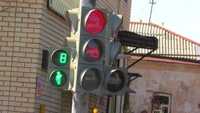 Traffic lights at the intersection. Produces a countdown stock video footage