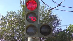 Traffic lights at the intersection. Produces a countdown stock video