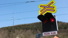 Traffic lights at a level crossing stock video footage