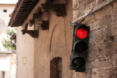 Traffic lights in medieval street Royalty Free Stock Photos