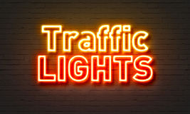 Traffic lights neon sign on brick wall background. Stock Photography