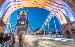 Traffic lights at night on Tower Bridge traffic, London - UK Stock Photo