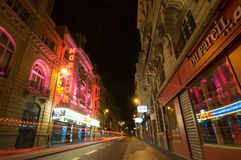 Traffic lights and night view of the Theatre Megador, Paris. PARIS - SEPT 17, 2014: Traffic lights and night view of the Theatre Megador. It founded in 1913 and royalty free stock image
