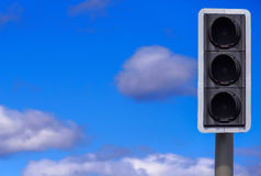 Traffic Lights, None Illuminated. Traffic lights against a blue sky background, none of the lights are illuminated, with copy space royalty free stock image