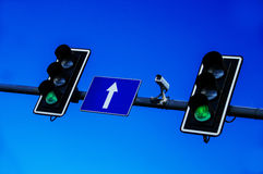 Traffic lights over blue sky Royalty Free Stock Images