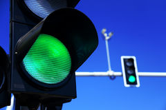 Traffic lights over blue sky Royalty Free Stock Photo