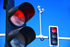 Traffic lights over blue sky Stock Photos